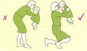 Como pegar bebé ao colo
